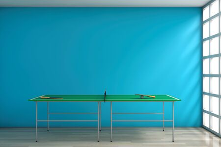 Ping-pong Tennis Table with Paddles against a blank blue wall in room. 3d Rendering Stock Photo