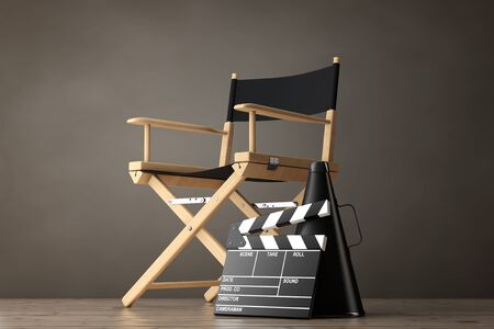 directors cut: Director Chair, Movie Clapper and Megaphone on a wooden floor. 3d Rendering Stock Photo