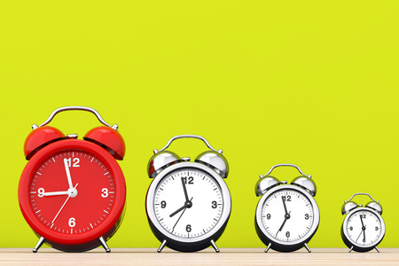 Vintage Alarm Clocks with Single Red One in front of yellow background. 3d Rendering Stock Photo