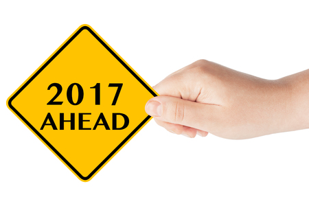 cautionary: 2017 year Ahead traffic sign in womans hand on a white background