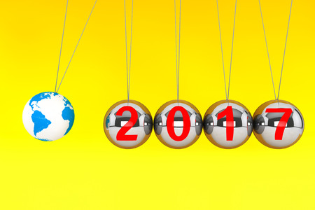 New Year concept. Spheres of Newton with Globe Earth and 2017 sign on a yellow background. 3d Rendering