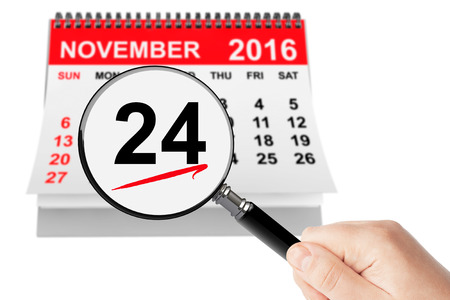 dinner date: Thanksgiving Day Concept. 24 November 2016 calendar with magnifier on a white background