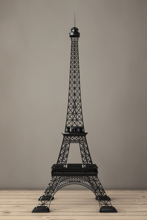 desk toy: Eiffel Tower Statue on a wooden table. 3d Rendering Stock Photo