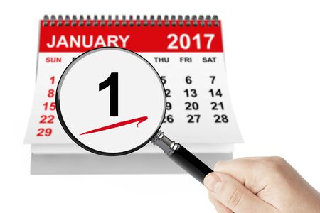 january 1: New Years Day Concept. 1 January 2017 calendar with magnifier on a white background
