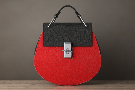 woman handle success: Luxury Red Leather Women Bags on a wooden table. 3d Rendering