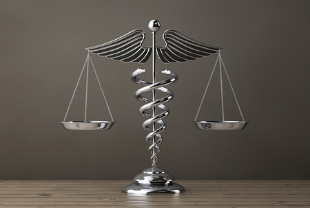 Silver Medical Caduceus Symbol as Scales on a wooden table. 3d Rendering