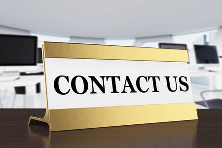 placecard: Golden Contact Us Plate on a wooden table. 3d Rendering Stock Photo