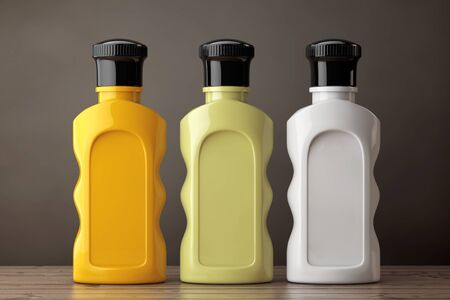 amenities: Blank Multicolour Hotel Cosmetic Bottles on a wooden table. 3d Rendering