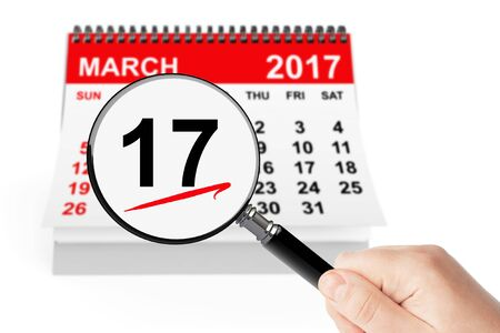 irish woman: St. Patrick Day Concept. 17 march 2017 calendar with magnifier on a white background