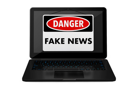 Fake News Danger Sign over Laptop Screen on a white background. 3d Rendering. Stock Photo