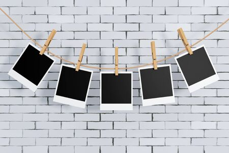 Photo Frames with Clothespins in front of brick wall. 3d Rendering.