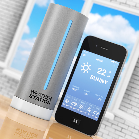 Modern Digital Wireless Home Weather Station with Mobile Phone with Weather on Screen in front of opened window. 3d Rendering.