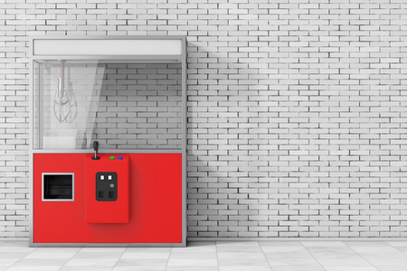 Empty Carnival Red Toy Claw Crane Arcade Machine in front of brick wall. 3d Rendering. Stock Photo