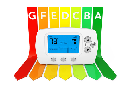 Modern Programming Thermostat over Energy Efficiency Rating Chart on a white background. 3d Rendering.