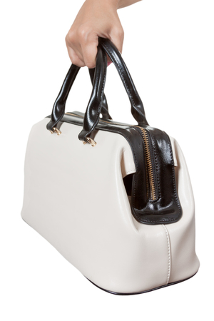 clutch bag: Woman Hand with Cream Coloured Leather Handbag on a white background.