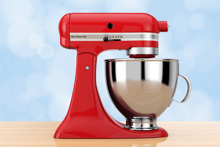 Red Kitchen Stand Food Mixer on a wooden table. 3d Rendering Фото со стока