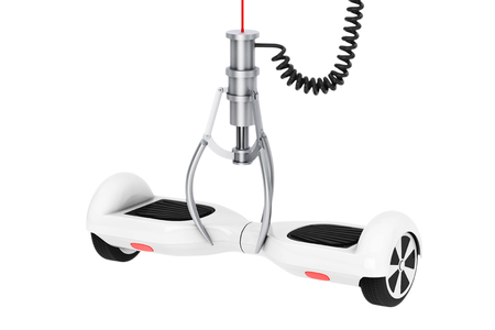 White Self Balancing Electric Scooter in a Chrome Robotic Claw on a white background. 3d Rendering. Stock Photo