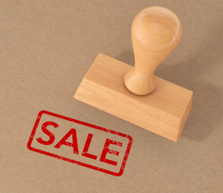 Red Rubber Sale Grunge Stamp over Cardboard extreme closeup. 3d Rendering.
