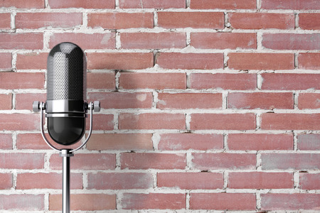 old fashioned: Vintage Silver Microphone in front of brick wall. 3d Rendering. Stock Photo