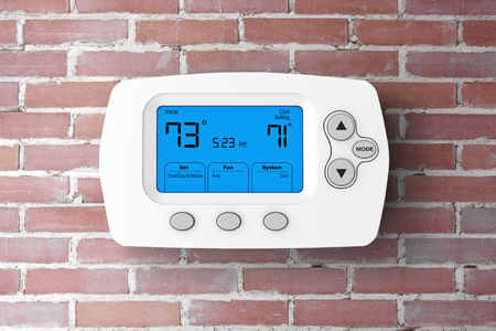 Modern Programming Thermostat in front of Brick Wall. 3d Rendering.