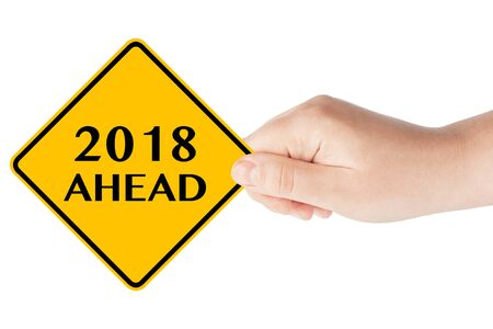 2018 Year Ahead Traffic Sign in Womans Hand on a white background Stock Photo