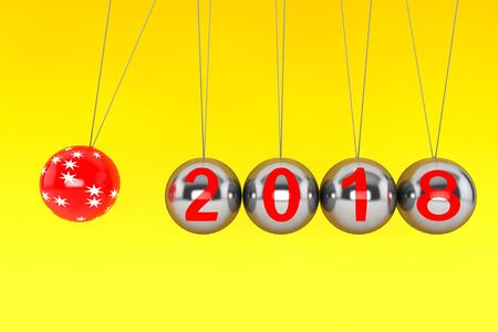 New Year concept. Spheres of Newton with 2018 on a yellow background. 3d Rendering Stock Photo