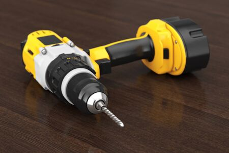 Yellow Rechargeable and Cordless Drill on a wooden table. 3d Rendering Stock Photo