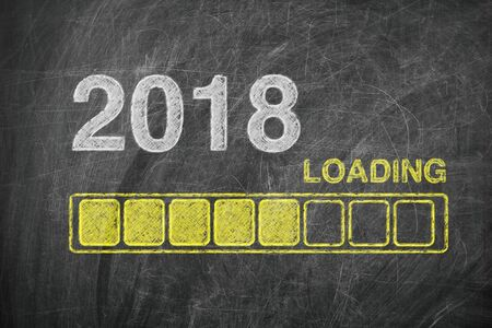 beginnings: Progress Bar Showing Loading of 2018 New Year on Chalkboard extreme closeup