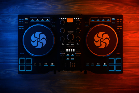 Black Modern DJ Set Turntable Mixer Equipment in Color Lights on a wooden table. 3d Rendering Stock Photo