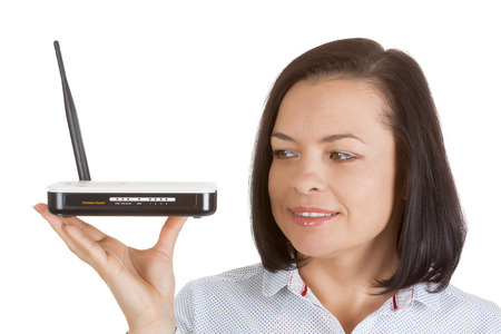 Wireless Modem Router Hardware in Woman Hands on a white background Stock Photo