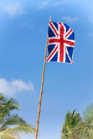 United Kingdom Flag on a Blue Sky Background extreme closeup.