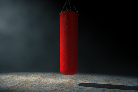 Red Leather Punching Bag for Boxing Training in the Volumetric Light on a black background. 3d Rendering