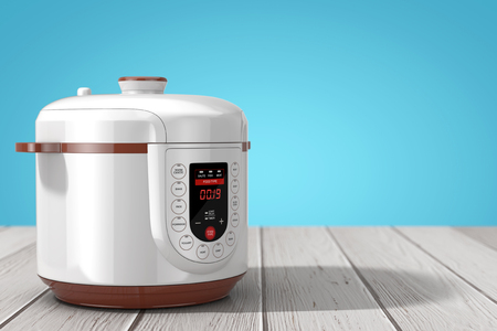 Modern Electric Multi Cooker on a wooden table. 3d Rendering