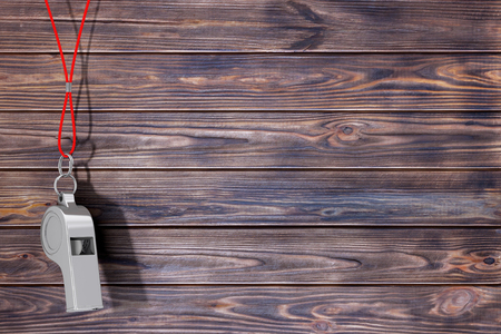 Classic Metal Coaches Whistle Hanging on Red Rope on a wooden planks background. 3d Rendering