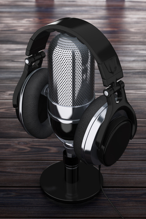 Black Headphones over Retro Microphone on a Wooden Table extreme closeup. 3d Rendering