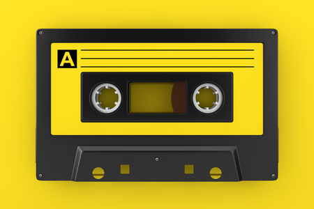 Yellow Old Vintage Audio Cassette Tape on a yellow background. 3d Rendering