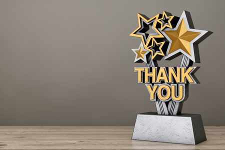 Award Trophy with Golden Thank You Sign on a wooden table. 3d Rendering