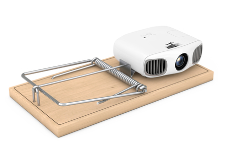 Cheap Electronic Problems Concept. Home Cinema Entertainment Full HD Projector in Wooden Mousetrap on a white background. 3d Rendering