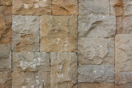 Primo piano estremo scheggiato del fondo del muro di pietra