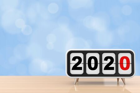 Retro Flip Clock with 2020 New year Sign on a wooden table. 3d Rendering 写真素材