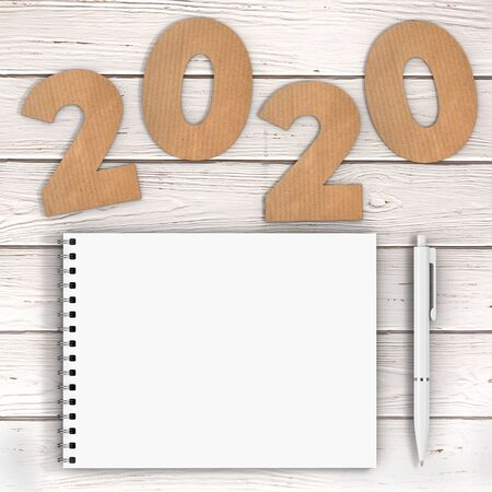 Cardstock Numbers 2020 Happy New Year Sign near White Spiral Paper Cover Notebook with Pen over wooden table background. 3d Rendering