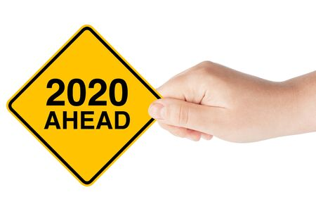 2020 Year Ahead Traffic Sign in Womans Hand on a white background