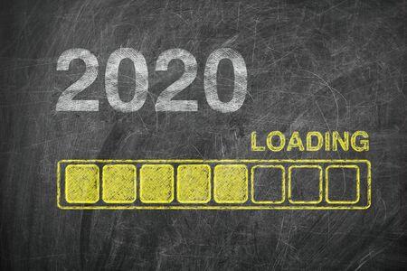 Progress Bar Showing Loading of 2020 New Year on Chalkboard extreme closeup