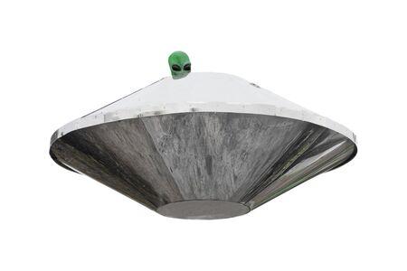 Metal UFO Alien Spaceship with Green Alien Person Head on a white background Foto de archivo - 133504756
