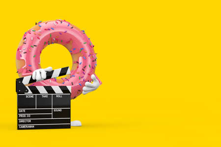 Big Strawberry Pink Glazed Donut Character Mascot with Movie Clapper Board on a yellow background. 3d Rendering 写真素材