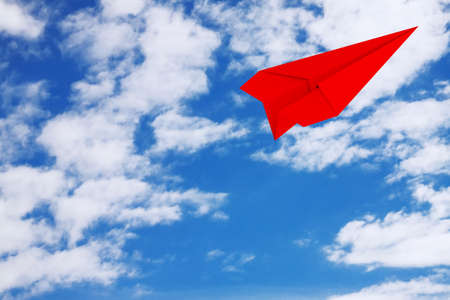 Red Origami Paper Airplane on a blue sky background. 3d Rendering