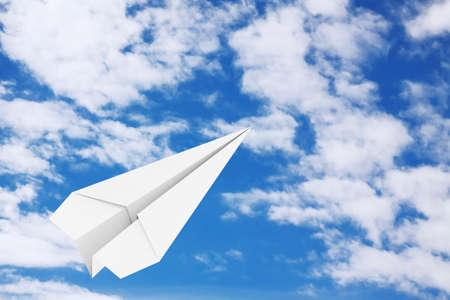 White Origami Paper Airplane on a blue sky background. 3d Rendering
