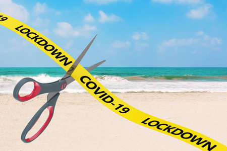The End of Lockdown Concept. Scissors Cut Yellow Ribbon with COVID-19 Lockdown Sign on an ocean beach background. 3d Rendering