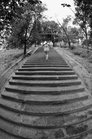 gets: the girl gets up the stairs.Odessa.Ucraine.the girl gets up the stairs Stock Photo