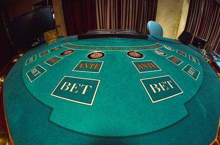 holdem: A poker table,shot on a fisheye